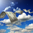 Royalty-Free Stock Photo: Dollar bills fly in flocks