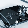 Stock Photo: Computer hard drive and a stethoscope