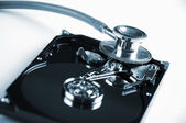 Computer hard drive and a stethoscope — Stock Photo