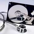 Stock Photo: Computer hard drive and stethoscope