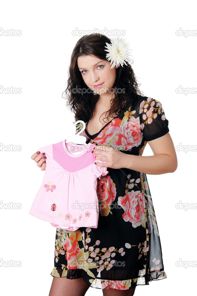 Charming young pregnant woman prepares to become a mother — Stock Photo #3690539