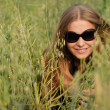 Woman with glasses in the field - Stock Photo
