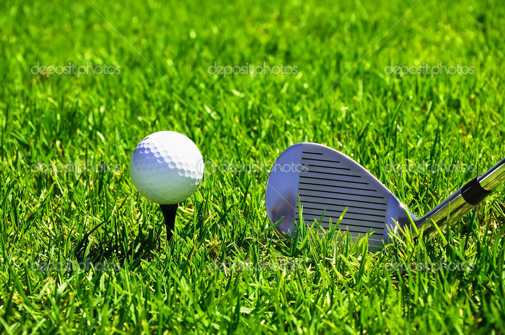 Ball and golf clubs on the bright green grass - as a symbol of success — Stock Photo #3805967