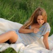 Girl sitting on green grass — Stock Photo
