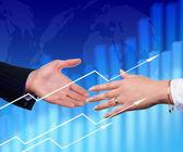 Apretón de manos sobre un fondo abstracto. — Foto de Stock