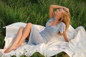 Girl sitting on green grass — Stock Photo