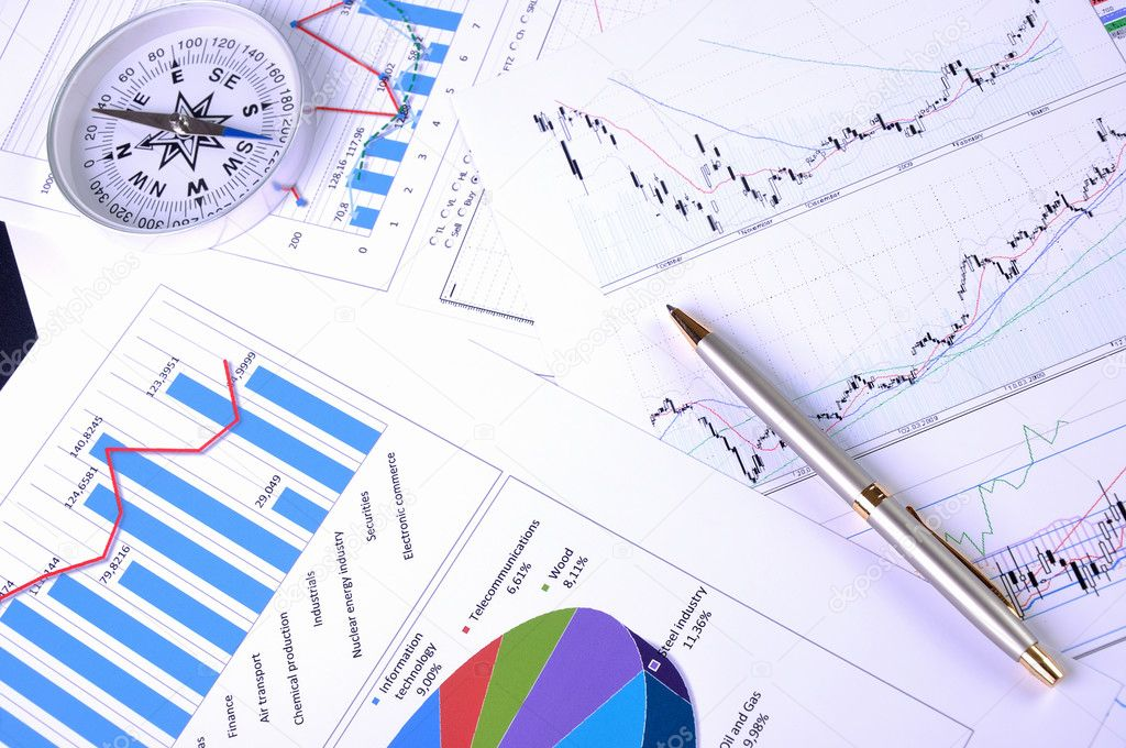 Graphs and charts. Workplace businessman. — Stock Photo #3991506