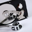 Stock Photo: Computer hard drive and stethoscope.