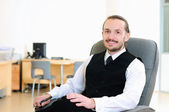 Business man in his office — Stock Photo