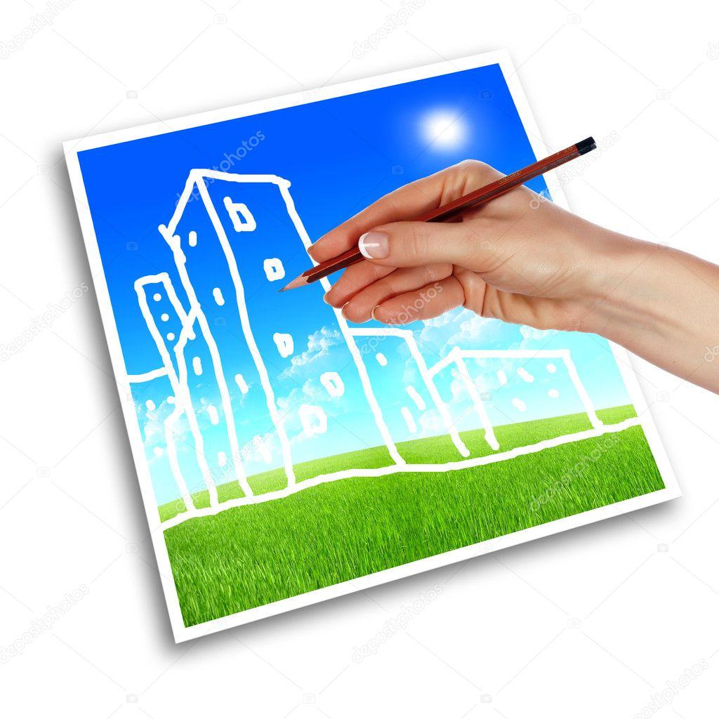 Een hand met een potlood tekenen van huizen stockfoto for Huizen tekenen
