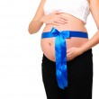 Abdomen a young pregnant woman — Stock Photo #4115013