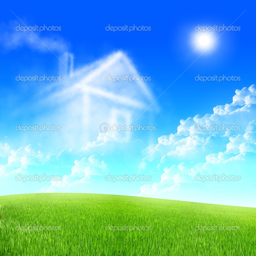 House of clouds in the blue sky against a background of green grass. — Stock Photo #4114818