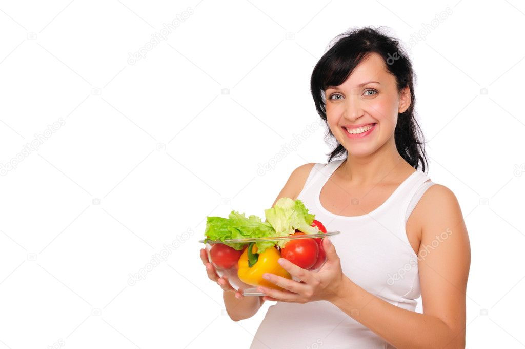 A young pregnant woman chooses a healthy natural food — Stock Photo #4115018