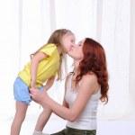 Little girl lovingly kisses — Stock Photo #4123226