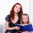 Little girl and her mother read a book — Stock Photo #4123266