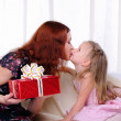 Little girl mom gives a holiday gift — Stock Photo #4123308