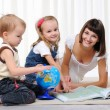 Young mother, her daughter and young son - Stock Photo