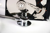 Computer hard drive and a stethoscope. — Stock Photo