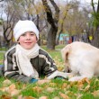 Boy playing in autumn park - Stock Photo