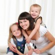 Young mother, her daughter and son — Stock Photo