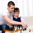 Royalty-Free Stock Photo: Dad and son playing chess