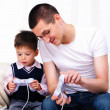 Royalty-Free Stock Photo: Young father and son together