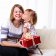 Mom gives daughter gift — Stock Photo