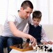 Dad and son playing chess — Foto Stock