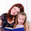 Little girl and her mother read a book — Stock Photo #4162319