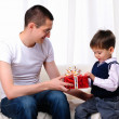 Stock Photo: Dad gives his son a gift