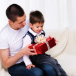 Dad gives his son a gift — Stock Photo