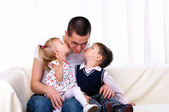 Young father with his daughter and son — Stock Photo