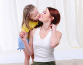 Little girl lovingly kisses — Stock Photo
