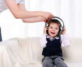 Little boy enjoys the music — Stock Photo