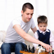 Dad and son playing chess — Stock Photo #4173553