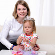 Young mother and her baby daughter — Stock Photo