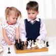 Brother and sister playing chess — Stock Photo #4173710