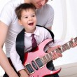 Young father teaches his young son — Stock Photo #4173720