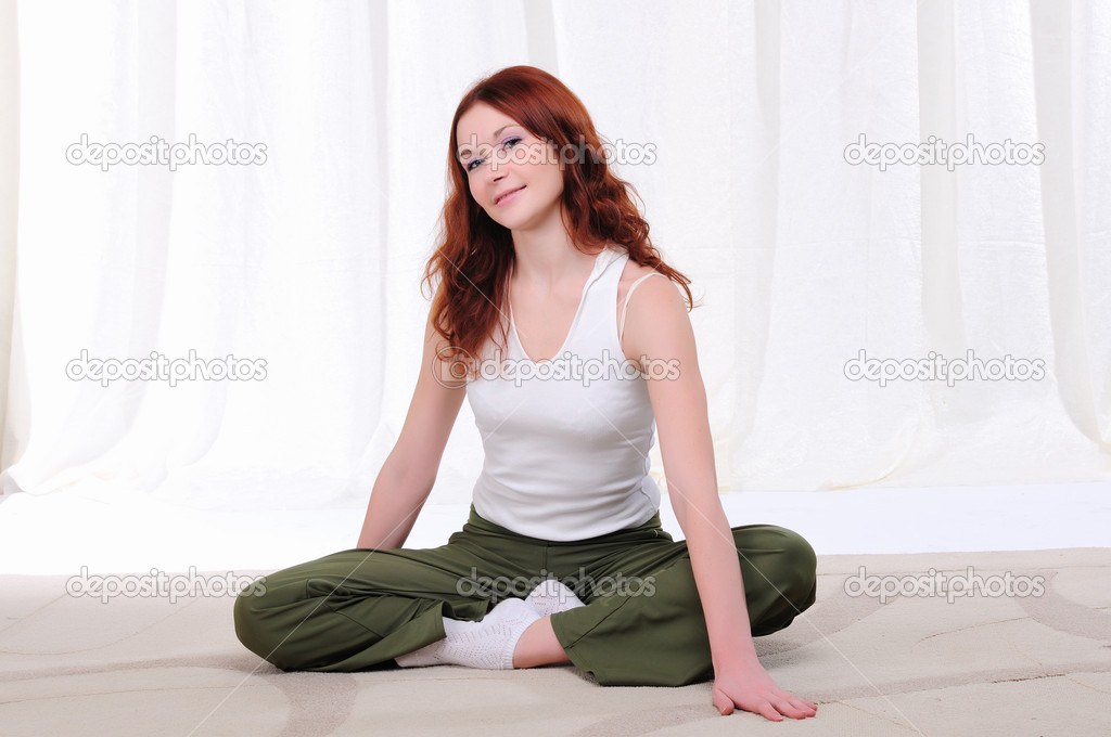 Young girl doing yoga exercises on sitting on the floor  Stock Photo #4173624