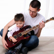 Young father teaches his young son — Stock Photo #4187168