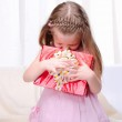 Little girl give a holiday gift — Stock Photo #4204640