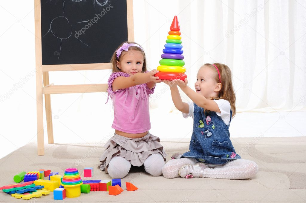 Two little girls play with friends and have fun — Stock Photo #4204050
