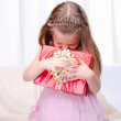 Little girl give a holiday gift — Stock Photo #4225216