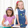 Foto Stock: Little girls are studying literature