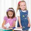 Little girls are studying literature — Stockfoto #4231668