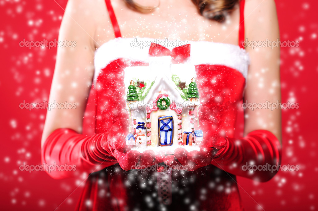 Portrait of a young girl dressed as Santa Claus on a red background. Girl gives gifts. Happy New Year and Merry Christmas! — Stock Photo #4231962
