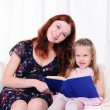 Little girl and her mother read a book — Stock Photo #4244982