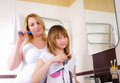Young girl and her mother — Stock Photo