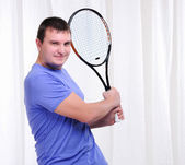 Young man with tennis racket — Stock Photo