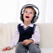 Stock Photo: Little boy enjoys music